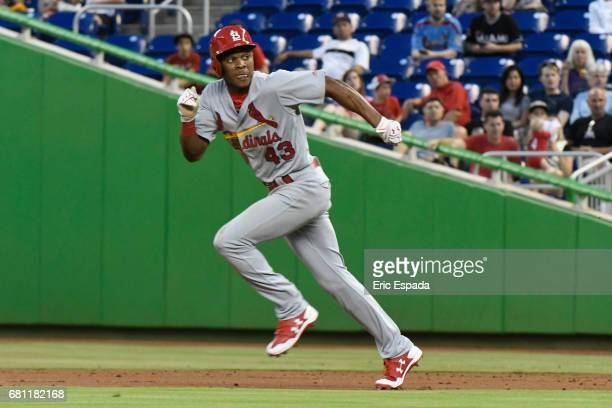 Magneuris Sierra of the St Louis Cardinals runs towards second base on a steal attempt during the 3rd inning against the Miami Marlins at Marlins...