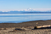 Looking east from beach of Boundary Bay Park in Tsawwassen, BC  towards Blaine and Mount Baker in Washington State on a beautiful, sunny, winter day