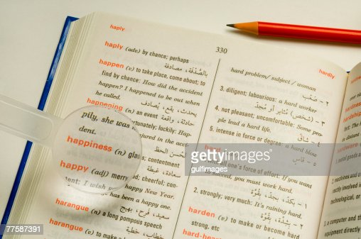 Magnifier on dictionary closeup elevated view stock photo for View dictionary