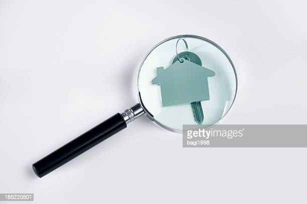 Magnifying glass and house key.