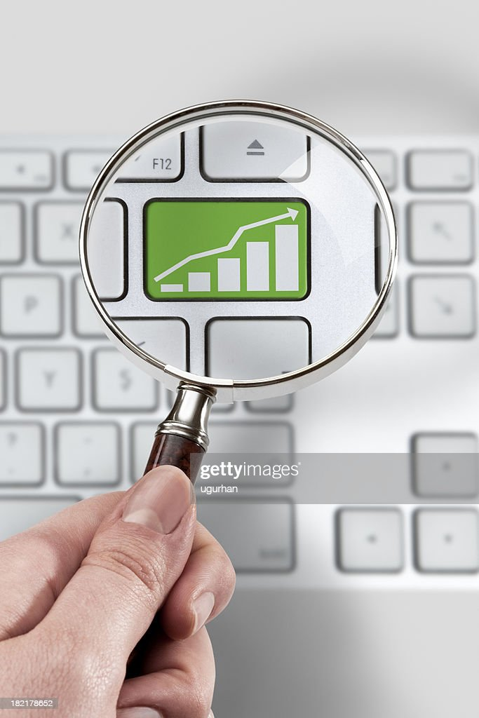 Magnifying glass and investment Concept : Stock Photo