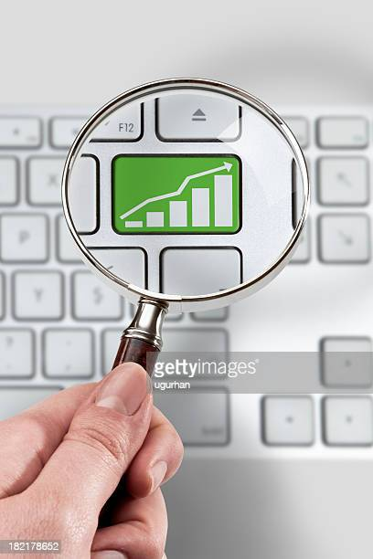 Magnifying glass and investment Concept