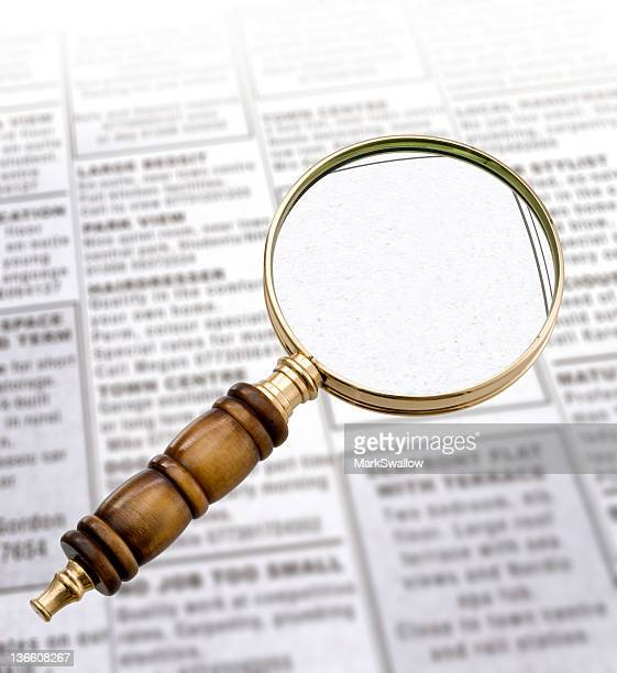 Magnifying Glass and newspaper
