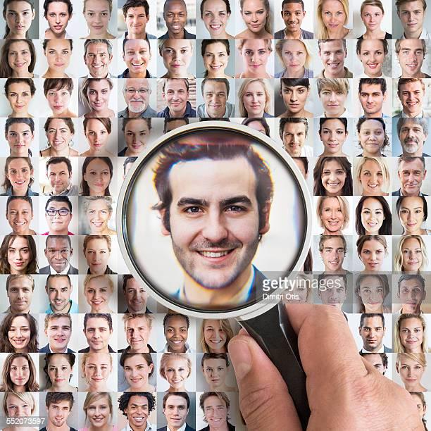 Magnifying glass enlarging man's portrait