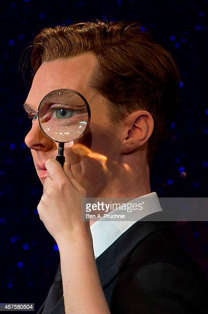 A magnifying glass is held over an eye as Madame Tussauds unveil new wax figure of Benedict Cumberbatch at Madame Tussauds on October 21 2014 in...