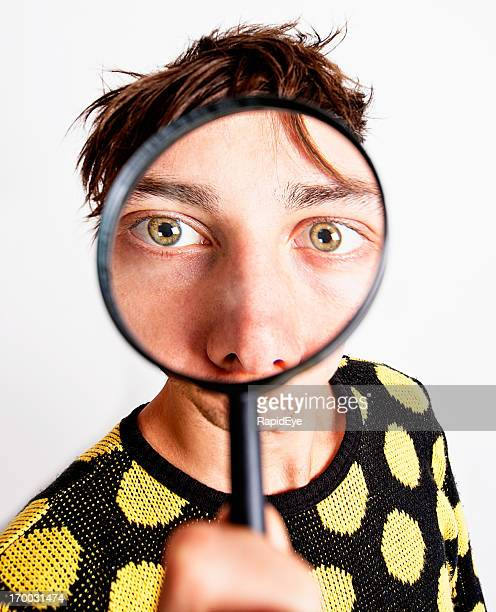 Magnifying glass makes man's eyes enormous!