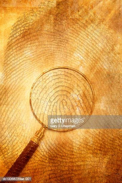 Magnifying glass on background of thumb print
