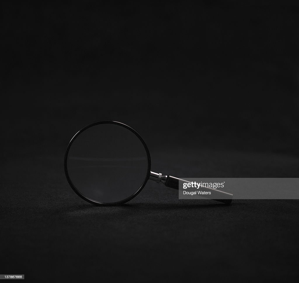 Magnifying glass on black background.