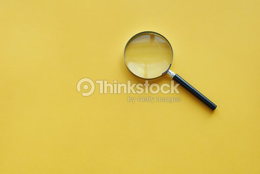 Magnifying glass on the orange background : Stock-Foto
