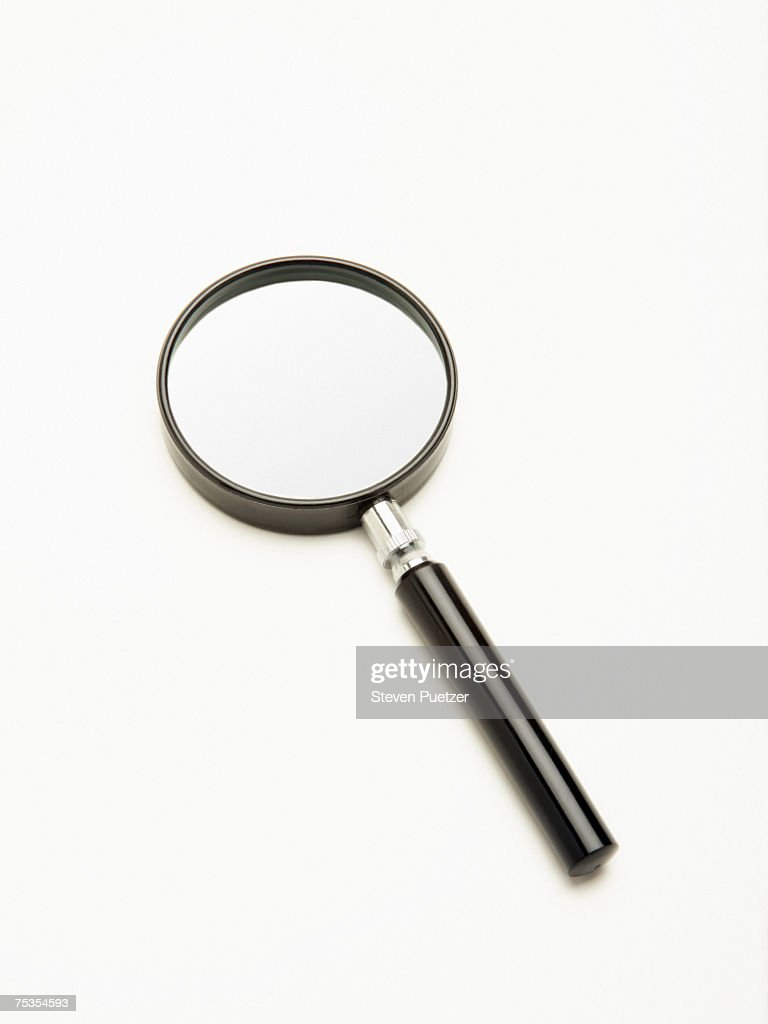 Magnifying glass on white background : Stock Photo