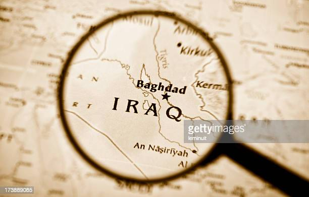 Magnifying glass over a map of Iraq.