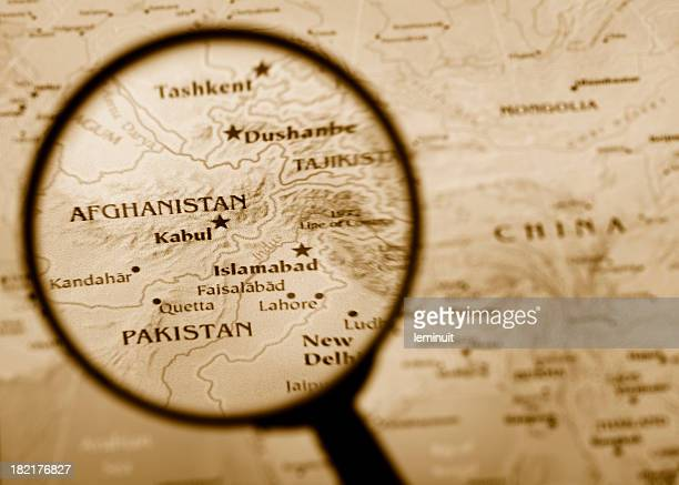 Magnifying glass over Afghanistan in a map. (XXL)