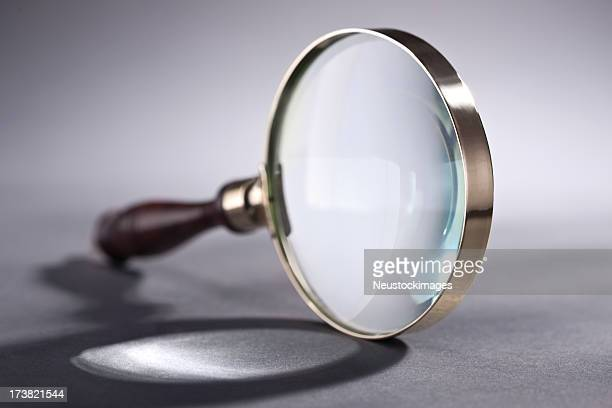Magnifying glass over isolated background