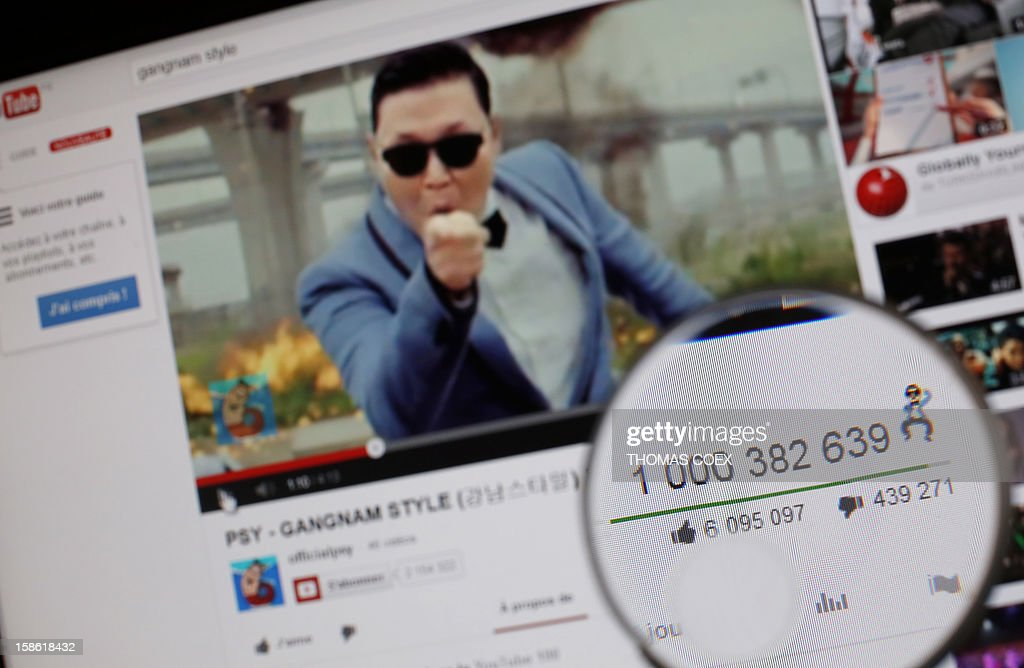 A magnifying glass shows the number of times that viewers have watched South Korean rapper Psy's video Gangnam style on YouTube on December 21, 2012. Psy's 'Gangnam Style' became the first video to hit a billion views on YouTube on Friday, marking a fresh milestone in the global craze for the South Korean rapper and his horse-riding dance. The view counter attached to 'Gangnam Style,' which was only posted on the video-sharing site July 15, clicked over into 10 figures at around 1550 GMT, confirming its status as the most viewed video in the site's history.