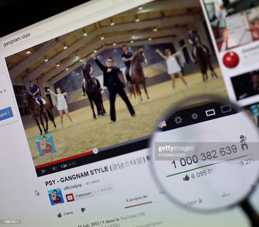A magnifying glass shows the number of times that viewers have watched South Korean rapper Psy's video Gangnam style on YouTube on December 21, 2012. Psy's 'Gangnam Style' became the first video to hit a billion views on YouTube on Friday, marking a fresh milestone in the global craze for the South Korean rapper and his horse-riding dance. The view counter attached to 'Gangnam Style,' which was only posted on the video-sharing site July 15, clicked over into 10 figures at around 1550 GMT, confirming its status as the most viewed video in the site's history. COEX
