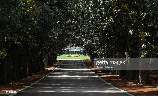 Magnolia Lane's 60 magnolia trees and the clubhouse are seen at Augusta National Golf Club before The Masters on April 1 2012 in Augusta Georgia