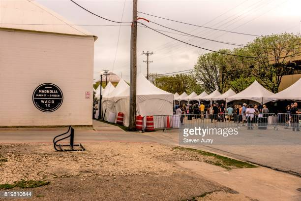 WACO, TX, USA  MARCH 18, 2017: Magnolia Market & Gardens building and Springtime at the Silos street fair tents in the distance