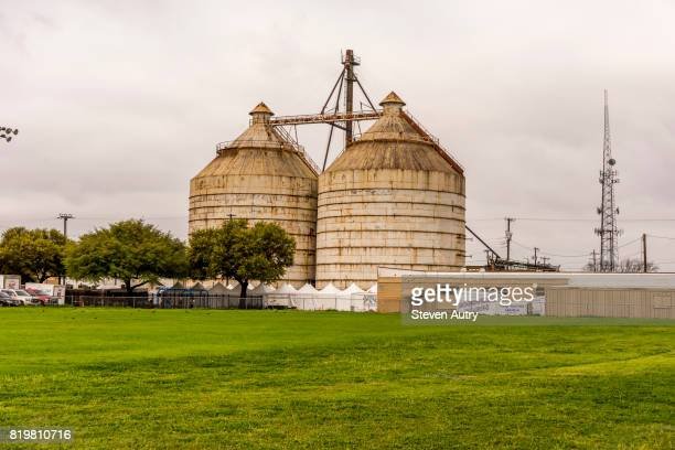 WACO, TX, USA  MARCH 18, 2017: Magnolia Silos and arts and crafts tents from a field behind the Silos..