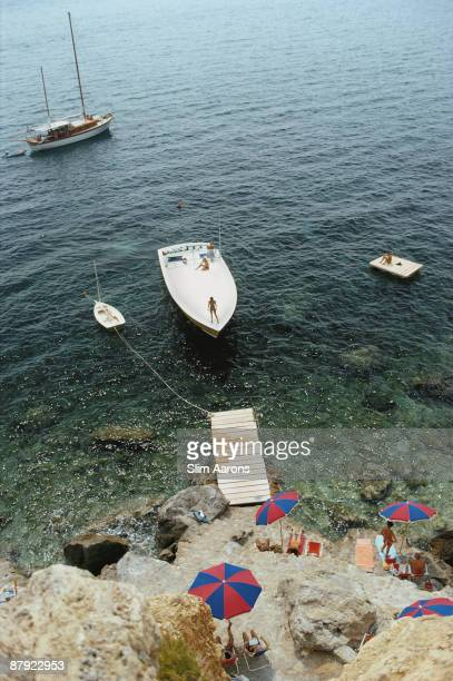 A Magnum motorboat belonging to Count Filippo Theodoli arrives at the private jetty of the Il Pellicano Hotel in Porto Ercole Italy August 1973