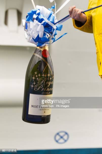 A magnum of Champagne is prepared ahead of the arrival of the Duchess of Cambridge at the Ocean Terminal in Southampton for the naming ceremony of...