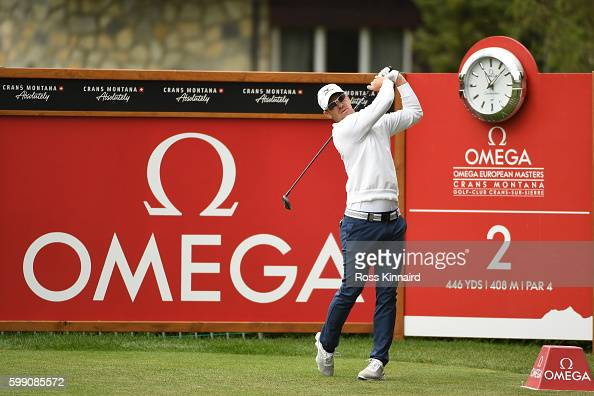 Magnus A Carlsson of Sweden hits his tee shot on the second hole during the final round of the Omega European Masters at CranssurSierre Golf Club on...