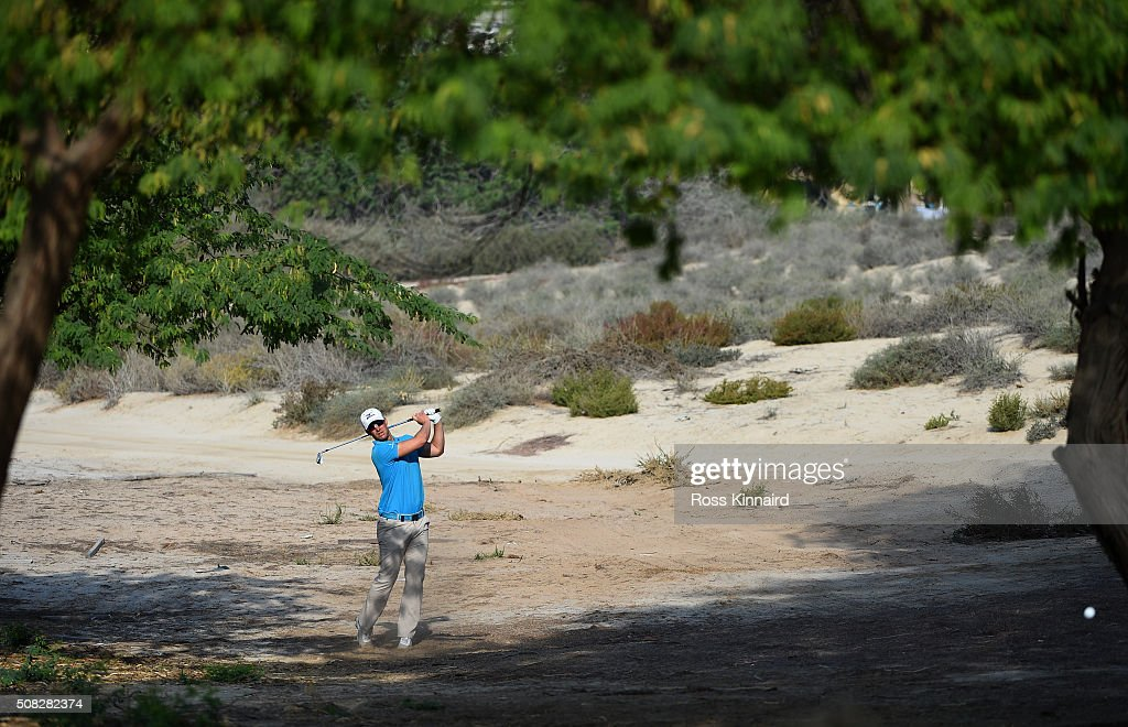Magnus A. Carlsson of Sweden plays a second shot on the third hole during the first round of the Omega Dubai Desert Classic at The Emirates Golf Club on February 4, 2016 in Dubai, United Arab Emirates.