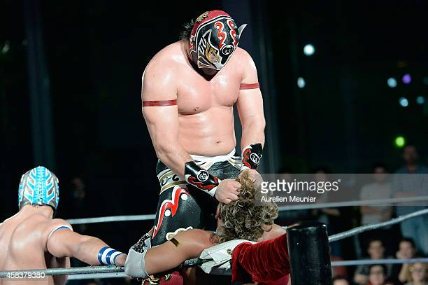 Magnus and Cassandro El Exotico perform onstage during the EXOTICOS VS LUCHADORES Lucha Libre Show hosted by La Fondation Cartier in Paris on...