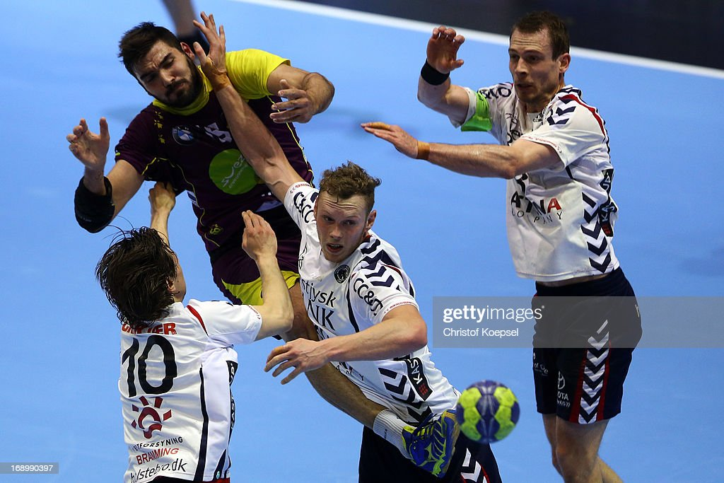 Magnus Bramming of Holstebro (L), jakob Green (3rd L) of Holstebro and Mads Christiansen of Holstebro (R) defend against Jorge Maqueda Pena of Nantes (2nd L) during the EHF Cup Semi Final match between Tvis Holstebro and HBC Nantes at Palais des Sports de Beaulieu on May 18, 2013 in Nantes, France.