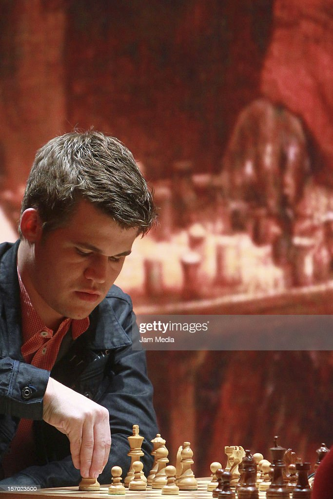 <a gi-track='captionPersonalityLinkClicked' href=/galleries/search?phrase=Magnus+Carlsen&family=editorial&specificpeople=2602660 ng-click='$event.stopPropagation()'>Magnus Carlsen</a> from Norway plays the final chess game Foursquare Blindfold and Rapid Tournament, as part of the Second Great International Chess Festival UNAM 2012 at the Sala Nezahualcoyotl on November 25, 2012, in Mexico City, Mexico.