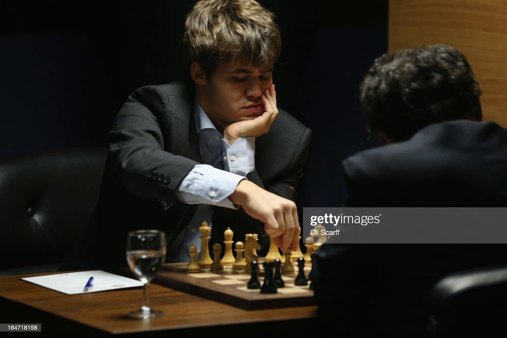 Magnus Carlsen (L), the world's number one chess player, competes against Israel's Boris Gelfand in the Candidates Tournament at the IET on Savoy Place on March 27, 2013 in London, England. Carlsen, 22, from Norway, became the youngest player to be ranked world No.1 on January 1, 2010 and his current chess ranking (a peak rating of 2872) is the highest of all time. The Candidates Tournament features eight of the world's top chess players and will determine which player will challenge Viswanathan Anand for the title of World Champion in November 2013. The tournament will be the strongest of its kind in history and have a total prize fund of 510,000 Euros.