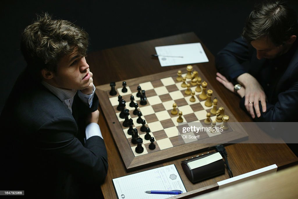 Magnus Carlsen (L), the world's number one chess player, plays Alexander Grischuk in the Candidates Tournament at the IET on Savoy Place on March 28, 2013 in London, England. Carlsen, 22, became the youngest player to be ranked world No.1 on January 1, 2010 and his current chess ranking (a peak rating of 2872) is the highest of all time. The Candidates Tournament features eight of the world's top chess players and will determine which player will challenge Viswanathan Anand for the title of World Champion in November 2013. The tournament will be the strongest of its kind in history and have a total prize fund of 510,000 Euros.