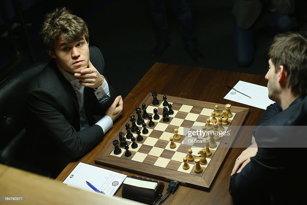 <a gi-track='captionPersonalityLinkClicked' href=/galleries/search?phrase=Magnus+Carlsen&family=editorial&specificpeople=2602660 ng-click='$event.stopPropagation()'>Magnus Carlsen</a> (L), the world's number one chess player, plays Alexander Grischuk in the Candidates Tournament at the IET on Savoy Place on March 28, 2013 in London, England. Carlsen, 22, became the youngest player to be ranked world No.1 on January 1, 2010 and his current chess ranking (a peak rating of 2872) is the highest of all time. The Candidates Tournament features eight of the world's top chess players and will determine which player will challenge Viswanathan Anand for the title of World Champion in November 2013. The tournament will be the strongest of its kind in history and have a total prize fund of 510,000 Euros.