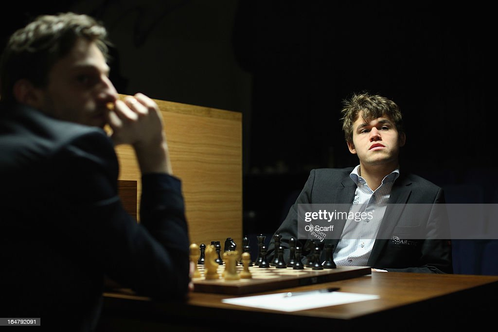 <a gi-track='captionPersonalityLinkClicked' href=/galleries/search?phrase=Magnus+Carlsen&family=editorial&specificpeople=2602660 ng-click='$event.stopPropagation()'>Magnus Carlsen</a> (R), the world's number one chess player, plays Alexander Grischuk in the Candidates Tournament at the IET on Savoy Place on March 28, 2013 in London, England. Carlsen, 22, became the youngest player to be ranked world No.1 on January 1, 2010 and his current chess ranking (a peak rating of 2872) is the highest of all time. The Candidates Tournament features eight of the world's top chess players and will determine which player will challenge Viswanathan Anand for the title of World Champion in November 2013. The tournament will be the strongest of its kind in history and have a total prize fund of 510,000 Euros.