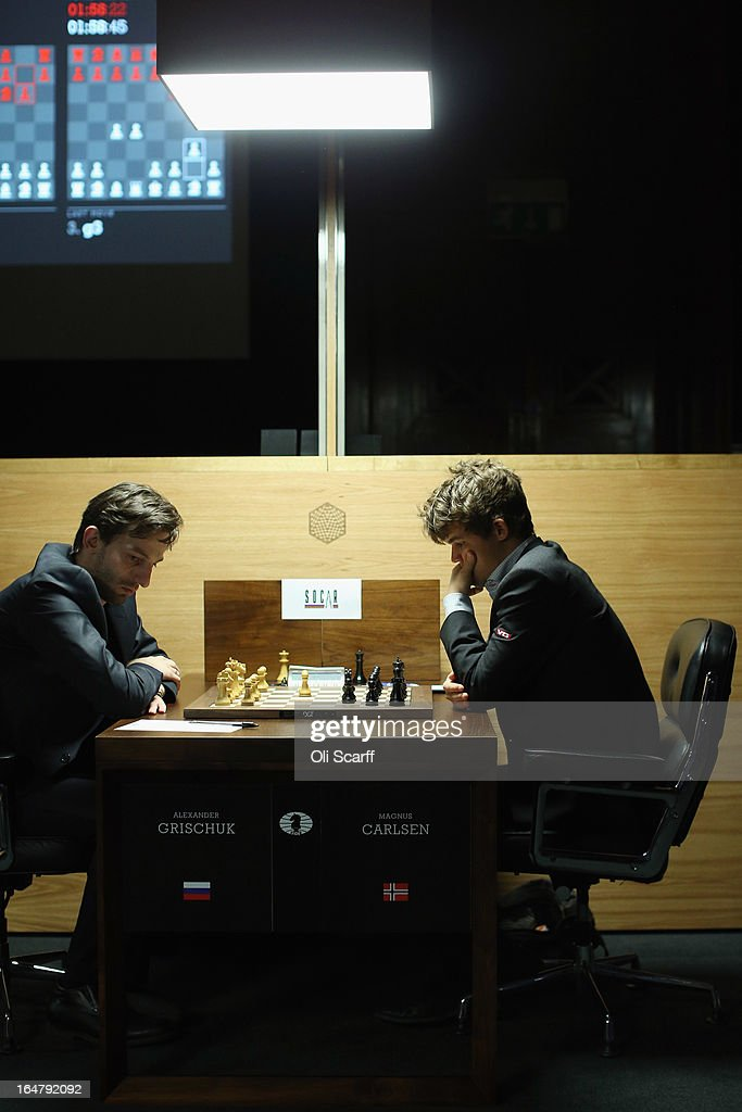 Magnus Carlsen (R), the world's number one chess player, plays Alexander Grischuk in the Candidates Tournament at the IET on Savoy Place on March 28, 2013 in London, England. Carlsen, 22, became the youngest player to be ranked world No.1 on January 1, 2010 and his current chess ranking (a peak rating of 2872) is the highest of all time. The Candidates Tournament features eight of the world's top chess players and will determine which player will challenge Viswanathan Anand for the title of World Champion in November 2013. The tournament will be the strongest of its kind in history and have a total prize fund of 510,000 Euros.