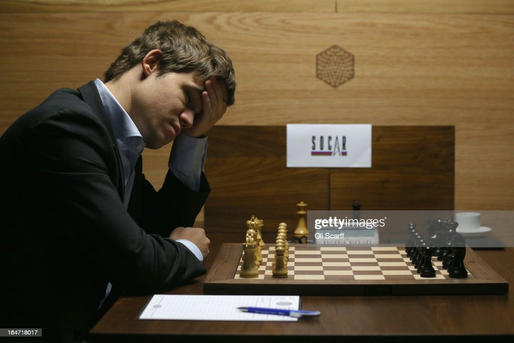 <a gi-track='captionPersonalityLinkClicked' href=/galleries/search?phrase=Magnus+Carlsen&family=editorial&specificpeople=2602660 ng-click='$event.stopPropagation()'>Magnus Carlsen</a>, the world's number one chess player, prepares to play Israel's Boris Gelfand in the Candidates Tournament at the IET on Savoy Place on March 27, 2013 in London, England. Carlsen, 22, from Norway, became the youngest player to be ranked world No.1 on January 1, 2010 and his current chess ranking (a peak rating of 2872) is the highest of all time. The Candidates Tournament features eight of the world's top chess players and will determine which player will challenge Viswanathan Anand for the title of World Champion in November 2013. The tournament will be the strongest of its kind in history and have a total prize fund of 510,000 Euros.