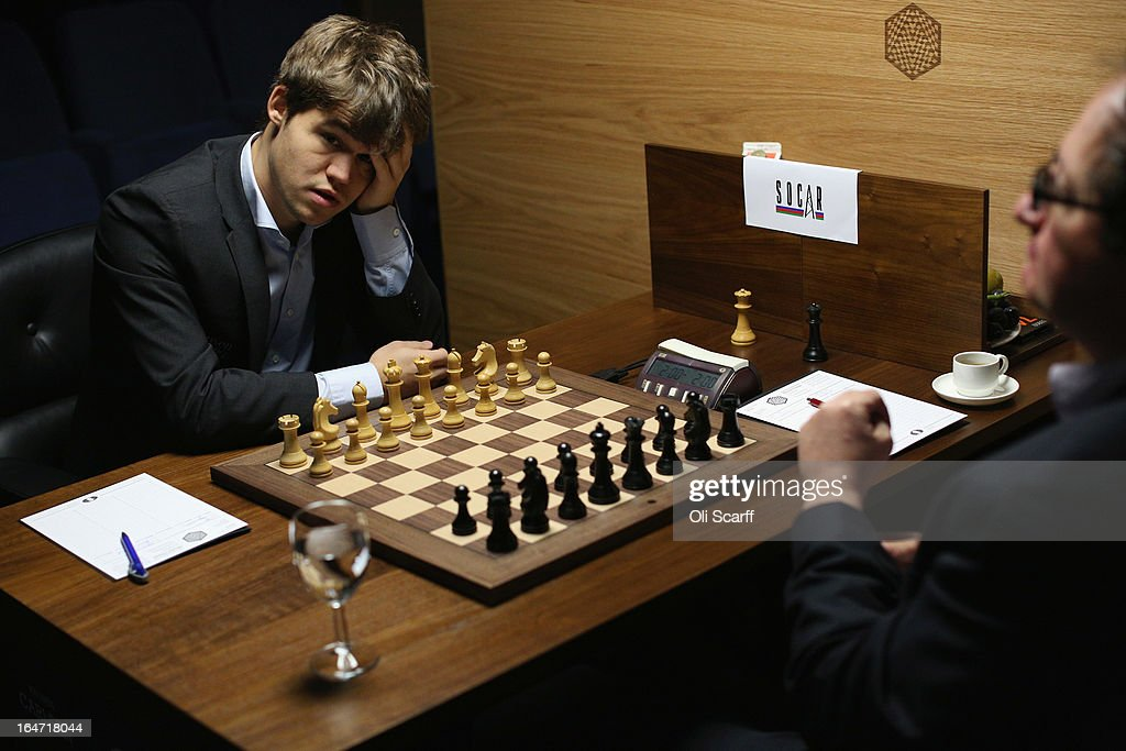 <a gi-track='captionPersonalityLinkClicked' href=/galleries/search?phrase=Magnus+Carlsen&family=editorial&specificpeople=2602660 ng-click='$event.stopPropagation()'>Magnus Carlsen</a> (L), the world's number one chess player, prepares to play Israel's <a gi-track='captionPersonalityLinkClicked' href=/galleries/search?phrase=Boris+Gelfand&family=editorial&specificpeople=790712 ng-click='$event.stopPropagation()'>Boris Gelfand</a> in the Candidates Tournament at the IET on Savoy Place on March 27, 2013 in London, England. Carlsen, 22, from Norway, became the youngest player to be ranked world No.1 on January 1, 2010 and his current chess ranking (a peak rating of 2872) is the highest of all time. The Candidates Tournament features eight of the world's top chess players and will determine which player will challenge Viswanathan Anand for the title of World Champion in November 2013. The tournament will be the strongest of its kind in history and have a total prize fund of 510,000 Euros.