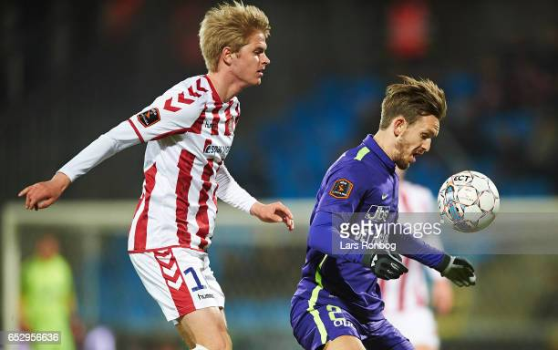 Magnus Christensen of AaB Aalborg and Kian Hansen of FC Midtjylland compete for the ball during the Danish Alka Superliga match between AaB Aalborg...