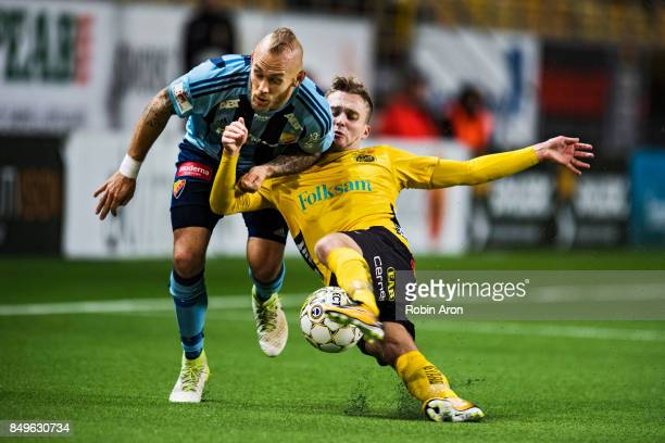 Magnus Eriksson of Djurgardens IF and Adam Lundqvist of IF Elfsborg battles for the ball during the Allsvenskan match between IF Elfsborg and...