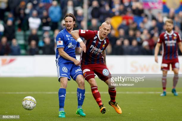 Magnus Eriksson of Djurgardens IF and Linus Hallenius of GIF Sundsvall during the Allsvenskan match between GIF Sundsvall and Djurgardens IF at...