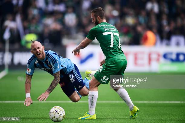 Magnus Eriksson of Djurgardens IF and Mats Solheim competes for the ball during the Allsvenskan match between Hammarby IF and Djurgardens IF at Tele2...
