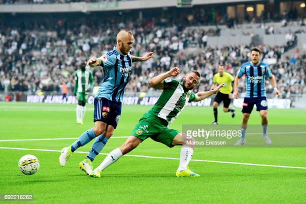 Magnus Eriksson of Djurgardens IF and Mats Solheim of Hammarby IF competes for the ball during the Allsvenskan match between Hammarby IF and...