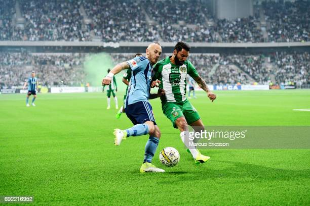 Magnus Eriksson of Djurgardens IF and Stefan Batan of Hammarby IF competes for the ball during the Allsvenskan match between Hammarby IF and...
