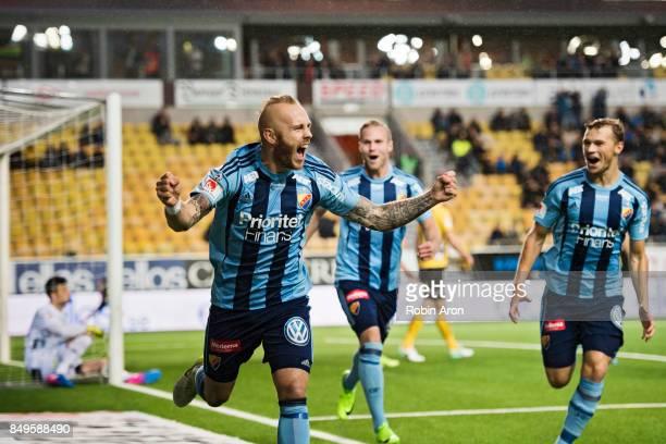Magnus Eriksson of Djurgardens IF celebrates after scoring the opening 01 behind Kevin StuhrEllegaard goalkeeper of IF Elfsborg during the...