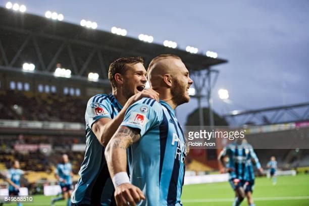 Magnus Eriksson of Djurgardens IF celebrates with teammates after scoring the opening 01 behind Kevin StuhrEllegaard goalkeeper of IF Elfsborg during...