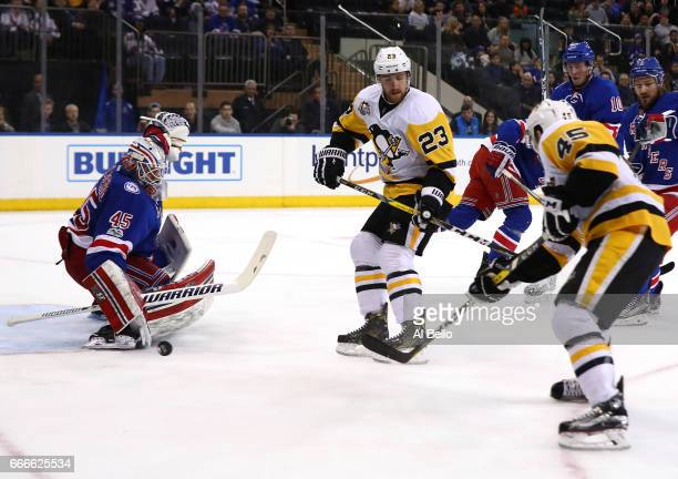 Magnus Hellberg of the New York Rangers makes a save against Josh Archibald of the Pittsburgh Penguins during their game at Madison Square Garden on...