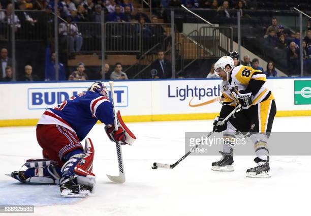 Magnus Hellberg of the New York Rangers Phil Kessel of the Pittsburgh Penguins during their game at Madison Square Garden on April 9 2017 in New York...