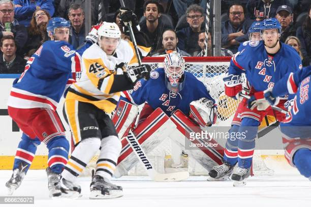 Magnus Hellberg of the New York Rangers tends the net as traffic builds at the front of the net against the Pittsburgh Penguins at Madison Square...