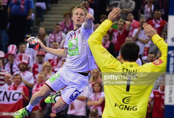 TOPSHOT Magnus Jondal of Norway scores a goal against goalkeeper Slawomir Szmal of Poland during their Main Round match of the Men's 2016 EHF...
