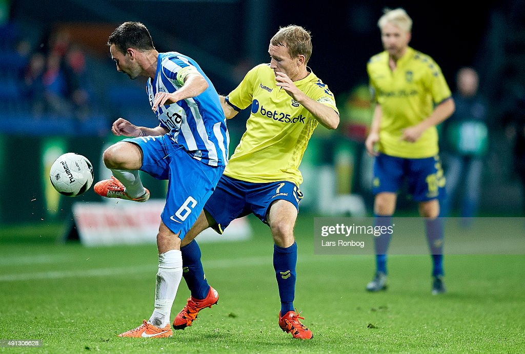 Magnus Lekven of Esbjerg fB and Thomas Kahlenberg of Brondby IF compete for the ball during the Danish Alka Superliga match between Brondby IF and Esbjerg fB at Brondby Stadion on October 4, 2015 in Brondby, Denmark.