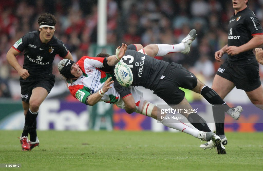 Magnus Lund of Biarritz is tackled by Florian Fritz during the Heineken Cup quarter final match between Biarritz Olympic and Toulouse at Estadio...